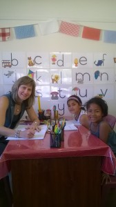 Teacher Celia with two bright students.